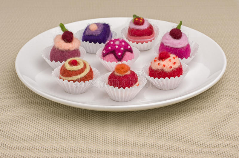 Colorful felt pralines stock images