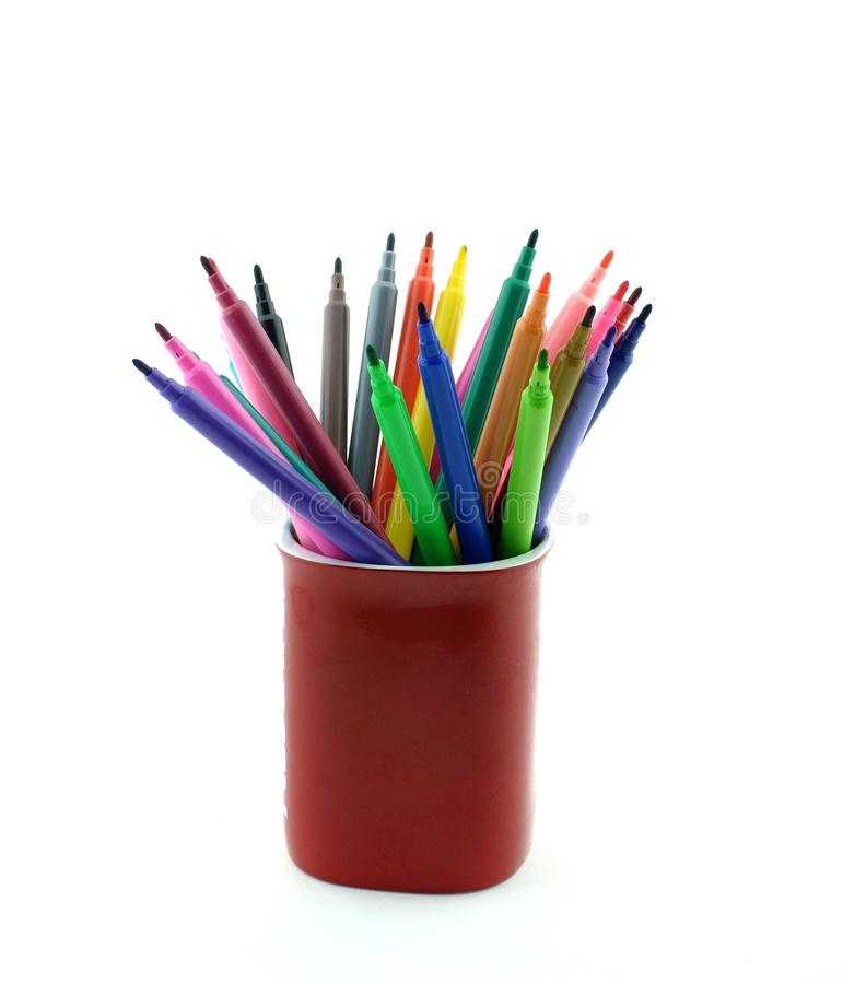 Colorful felt tip pens. Colorful assorted felt tip pens in a red porcelain mug royalty free stock photos