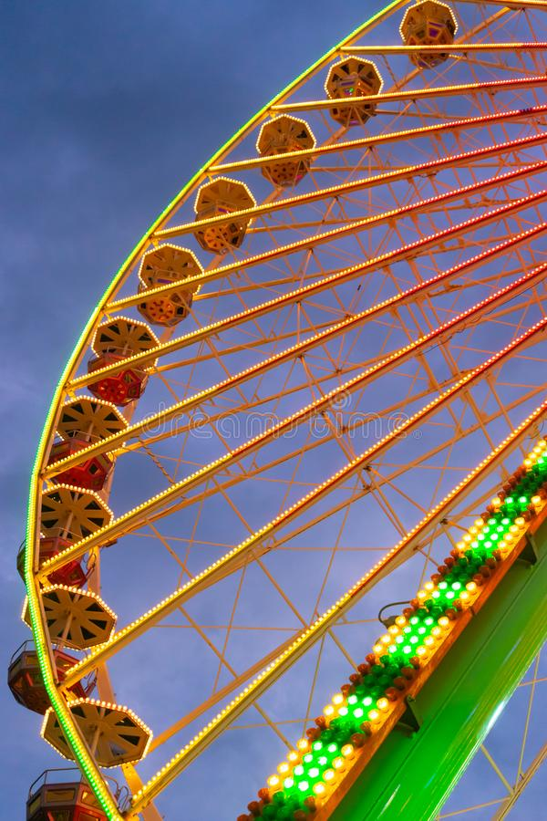 Colorful ferris wheel at carnival fair from below stock images