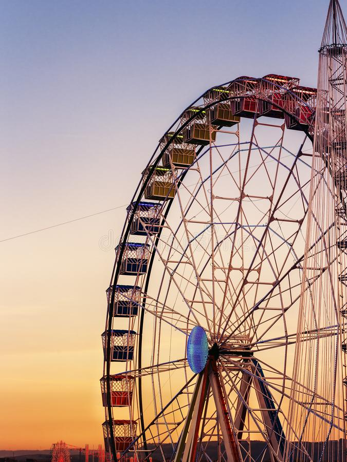 Colorful ferris whell at sunset. View of rounded colorful ferris whell at sunset in Madrid.Spain royalty free stock images