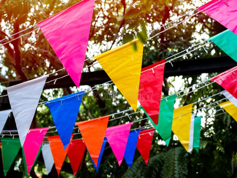 Colorful festival flags hanging in the.garden royalty free stock photos