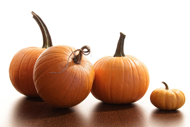 Colorful festive pumpkins on wood table stock photo