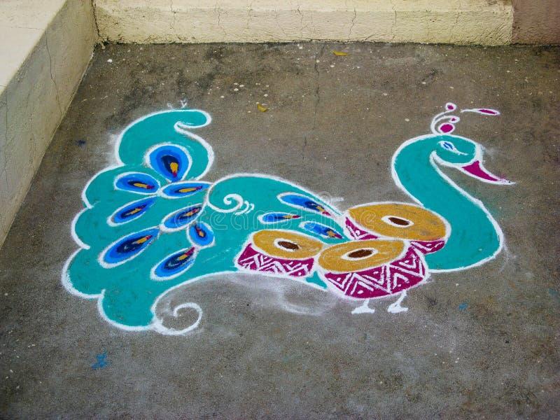 Rangoli. Figure-prayer around the front door. stock images