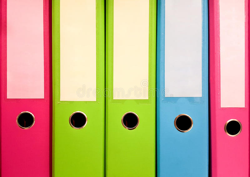Colorful file folders. Standing on the shelves stock photo