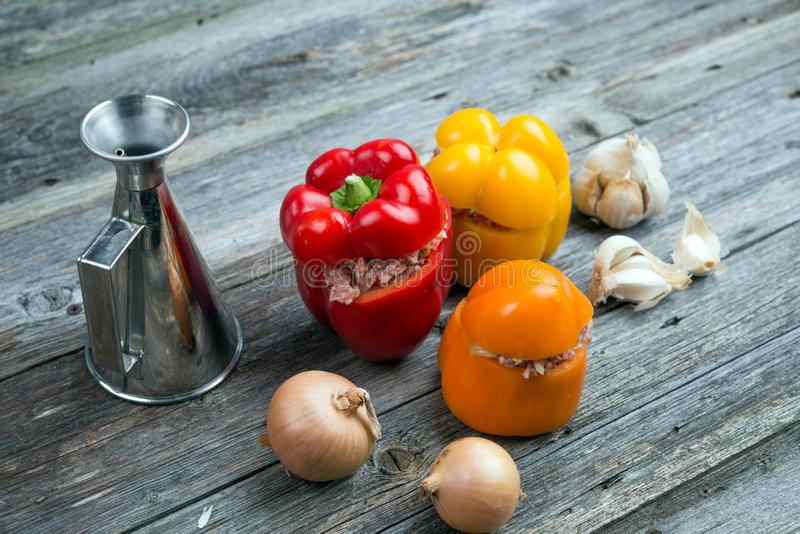 Filled pepper,oil,garlic and onion on wooden ground. Colorful filled pepper,oil,garlic and onion on wooden ground stock images