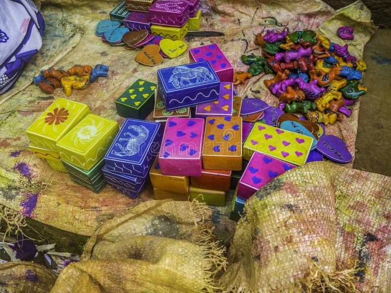 Colorful, almost finished, African soapstone wild animal souvenirs and gifts hand carved, painted and polished. Colors of the rainbow, waiting to be packed for royalty free stock photography
