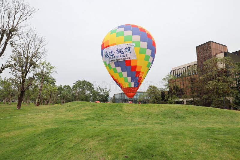 The colorful fire balloon. On green grass stock photos