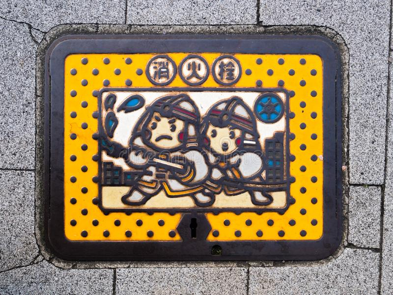 Colorful fire hydrant manhole cover in Tokyo, Japan stock photography