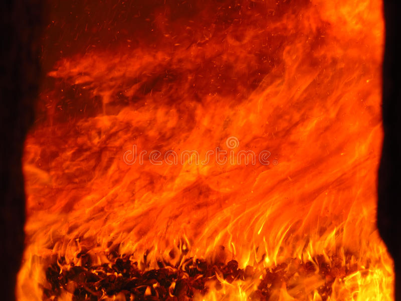 Colorful fire in an industrial furnace royalty free stock photography