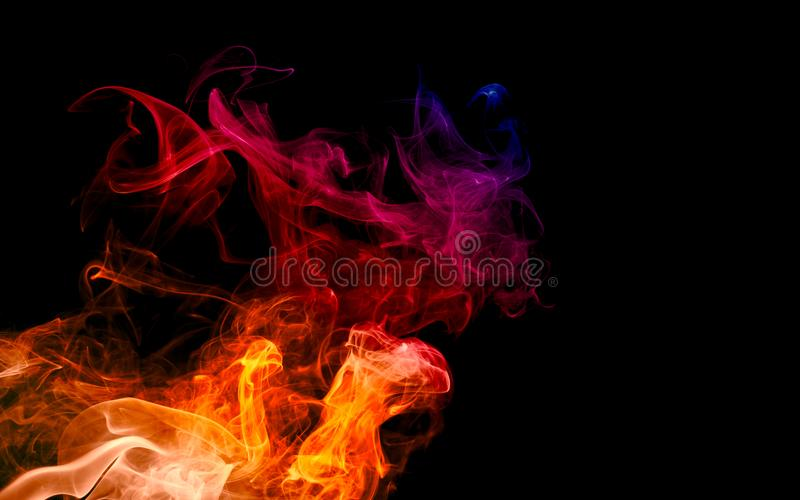 Colorful fire and smoke with light texture abstract isolated on dark black background stock images