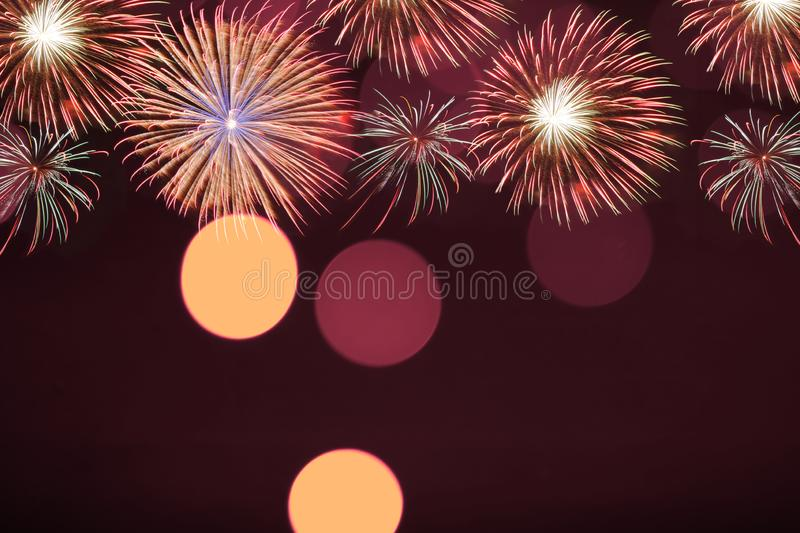 Colorful firework and blurred bokeh light with copy space in Christmas and New Year. Abstract background holiday concept royalty free stock image