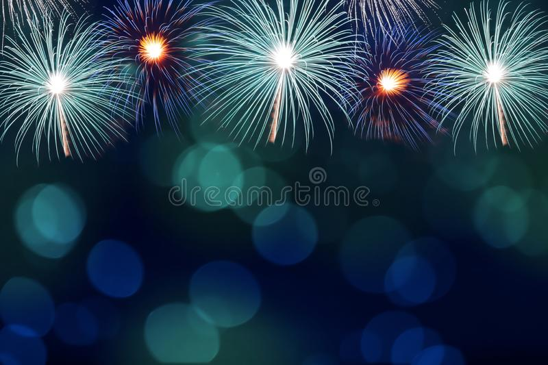 Colorful firework and blurred bokeh light with copy space in Christmas and New Year. Abstract background holiday concept royalty free stock images