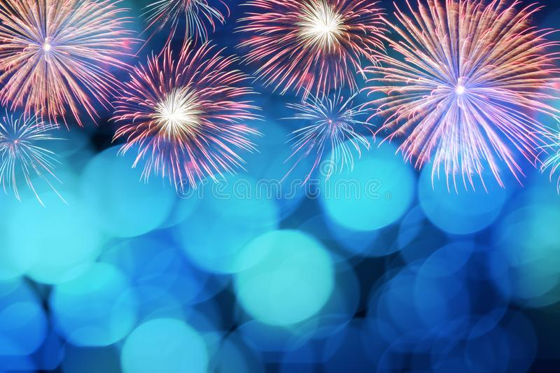 Colorful firework and blurred bokeh light with copy space in Christmas and New Year. Abstract background holiday concept royalty free stock photo