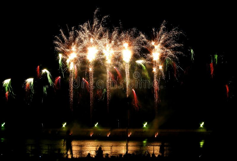 Colorful firework in night sky royalty free stock photography