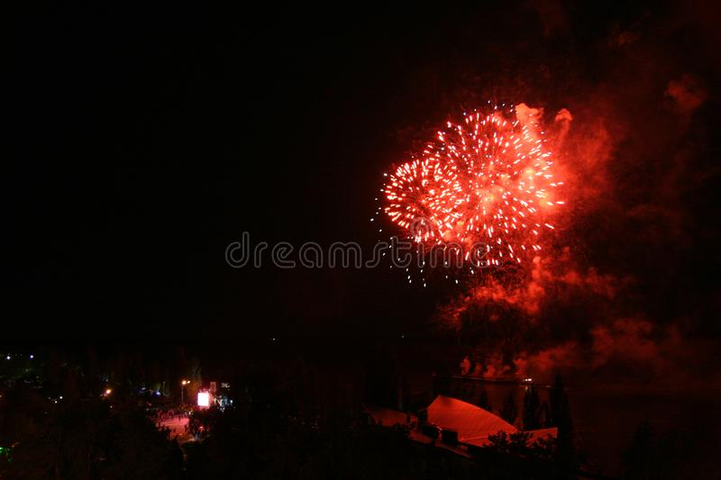 Colorful firework over the city and river stock photography