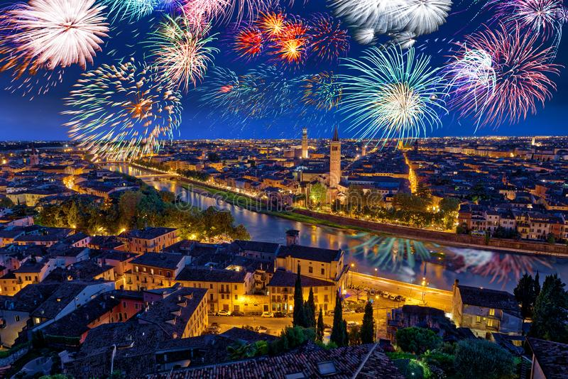 Colorful Fireworks above Verona Cityscape, in Italy, Celebrating New Years Eve royalty free stock photography