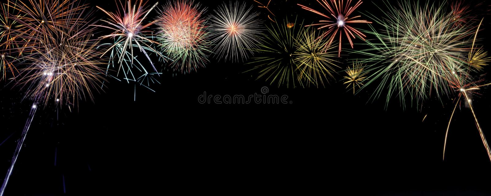 Colorful fireworks banner with room for writing. Colorful bursting fireworks across the top of a large banner. Lots of room for words, perfect for holidays and stock photo