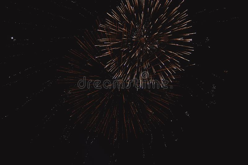 Colorful fireworks on the black sky background stock image