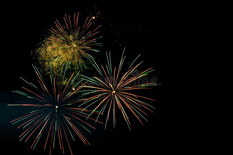 Colorful fireworks on the black sky background royalty free stock photo