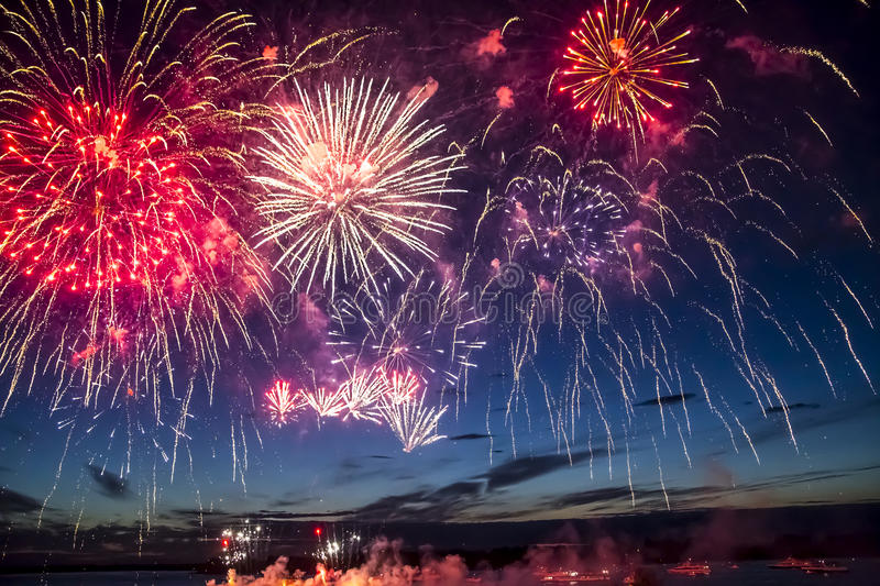 Colorful fireworks on the black sky background stock photos