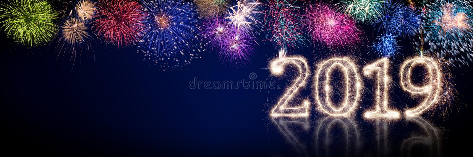 Colorful fireworks and bright sparkler pyrotechnic number 2019 h. Appy new year sylvester concept on black blue panorama background stock illustration