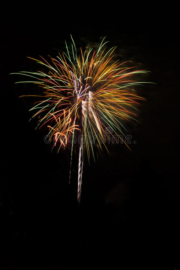 Colorful Fireworks Burst on Black Background royalty free stock images