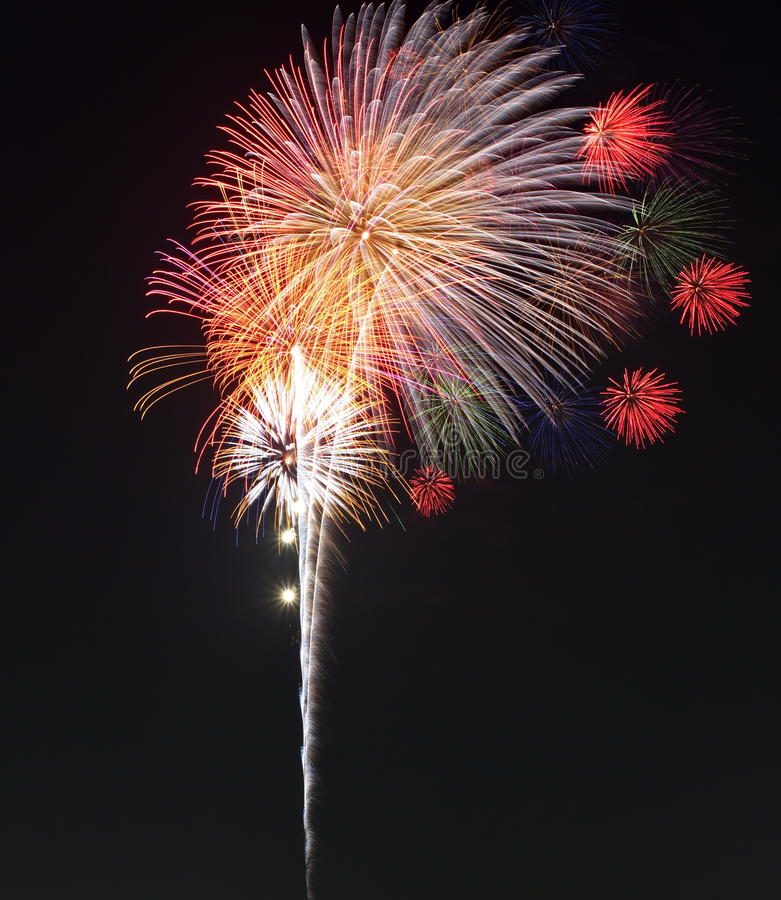 Colorful fireworks bursting in the night sky royalty free stock image