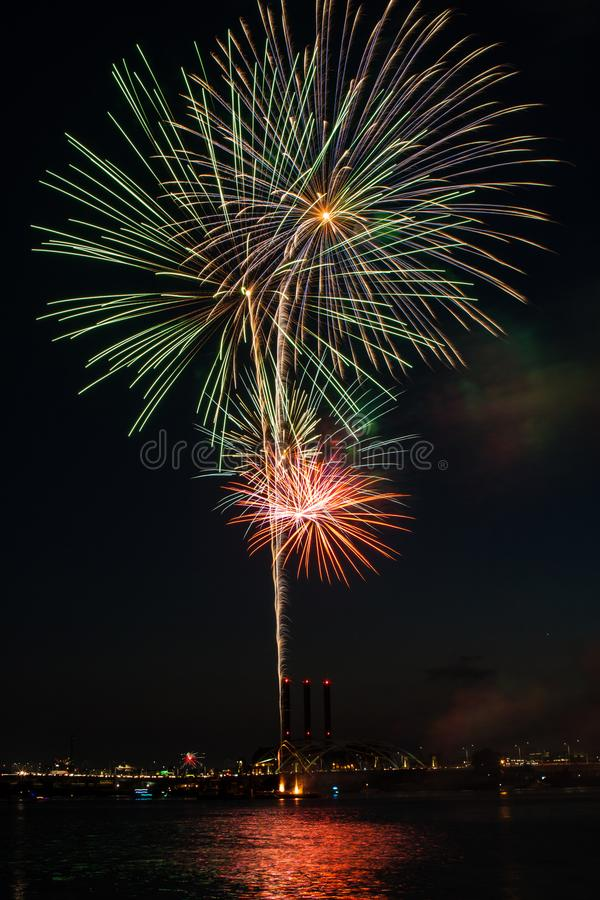 Colorful Fireworks Bursting over Providence. Beautiful fireworks Bursting over Providence city scape at blue hour with towers in background and red reflection in royalty free stock photos