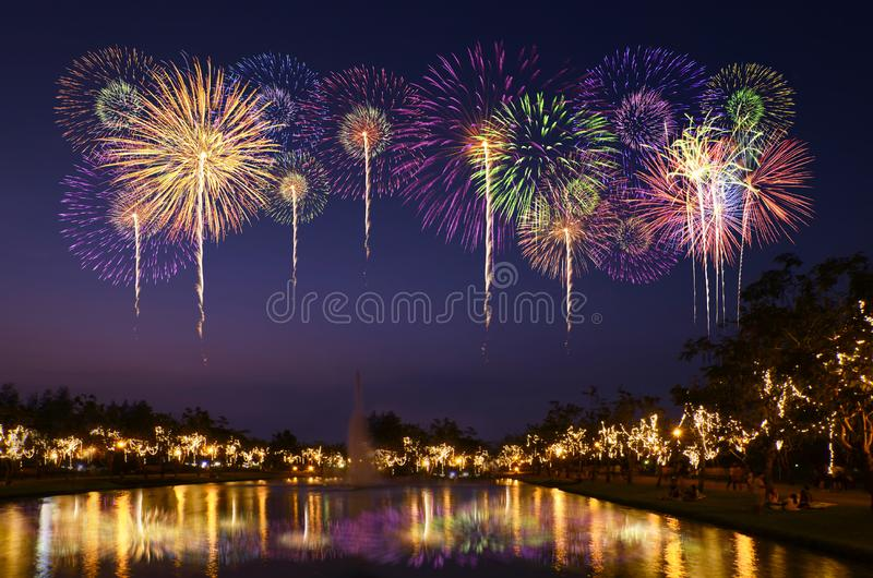 Colorful fireworks celebration and the city night light background. royalty free stock photography