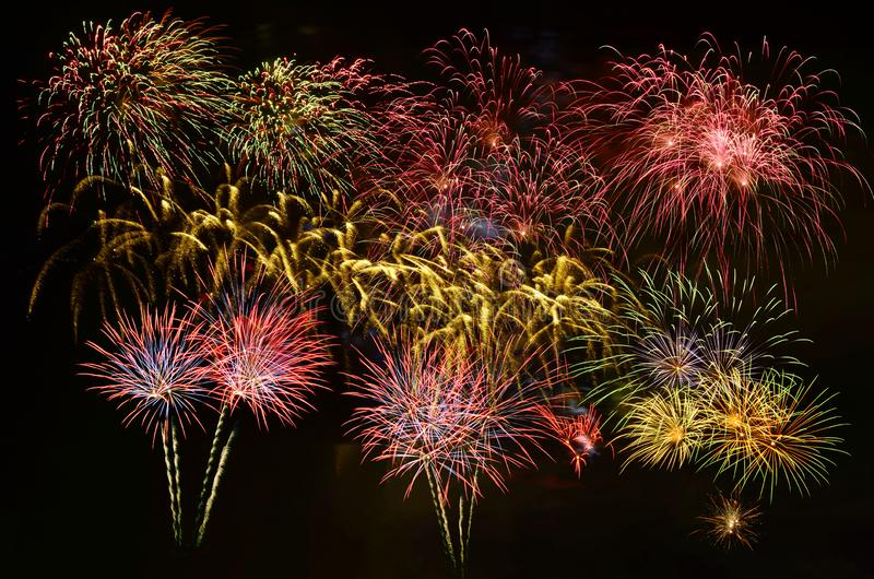 Colorful fireworks celebration and the night sky background royalty free stock photos