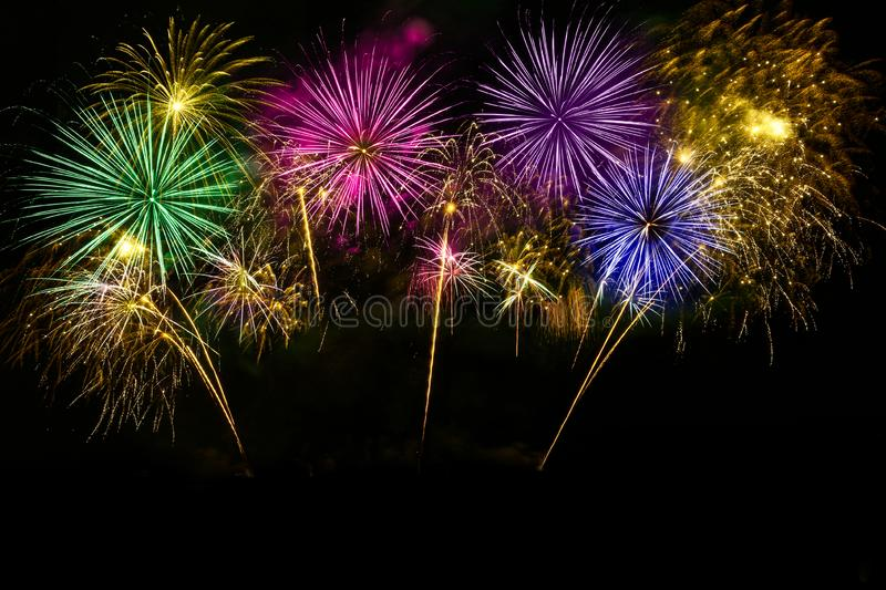 Colorful fireworks celebration on the midnight sky stock images