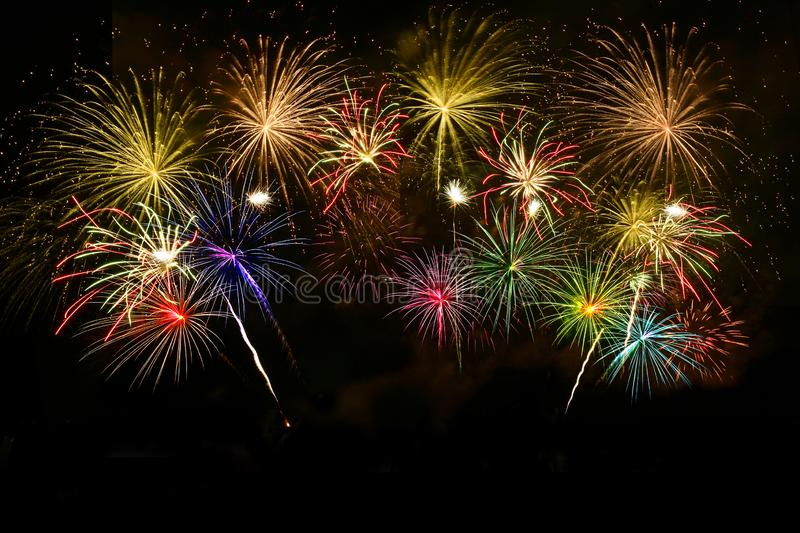 Colorful fireworks celebration on midnight sky royalty free stock image