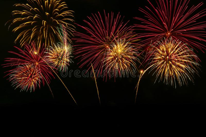 Colorful fireworks celebration and the midnight sky background stock images