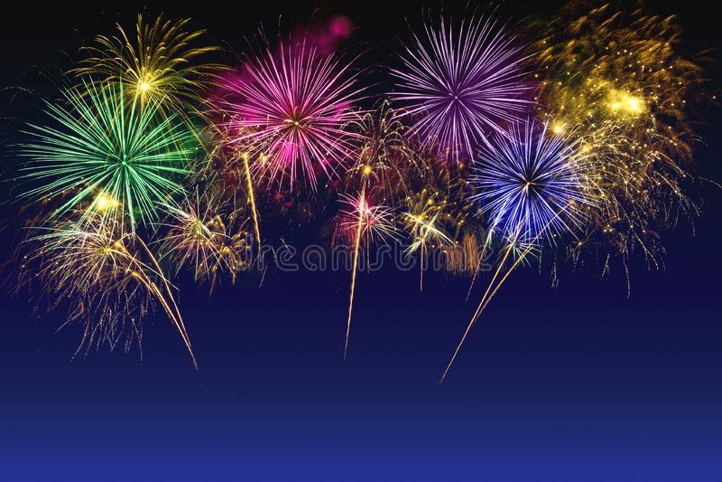 Colorful fireworks celebration on the twilight sky royalty free stock photos