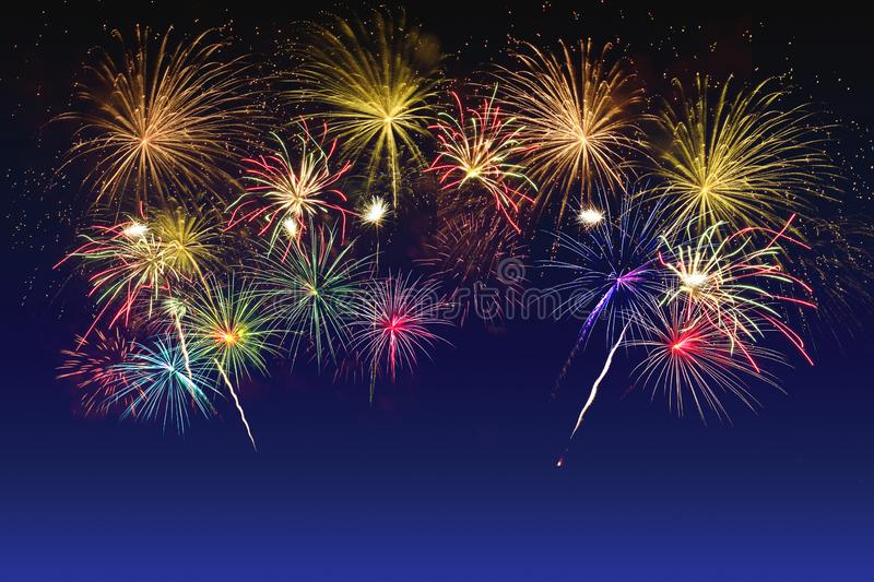Colorful fireworks celebration on twilight sky royalty free stock photography