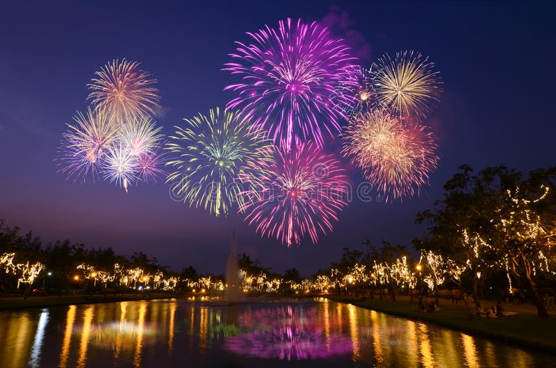 Colorful fireworks celebration and the city night light background. stock photos