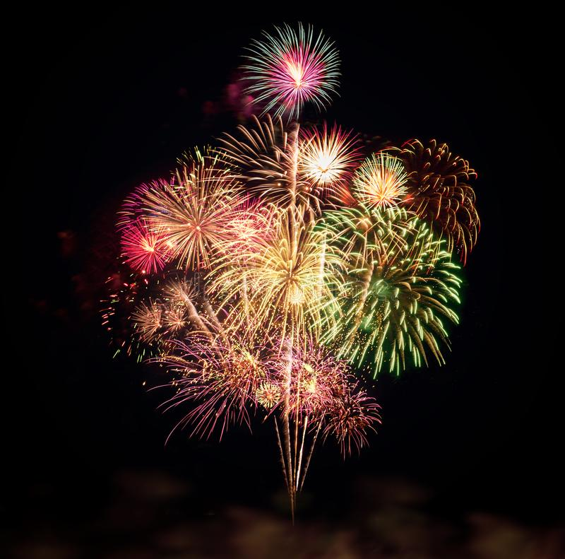 Colorful fireworks for celebrations on black background royalty free stock image