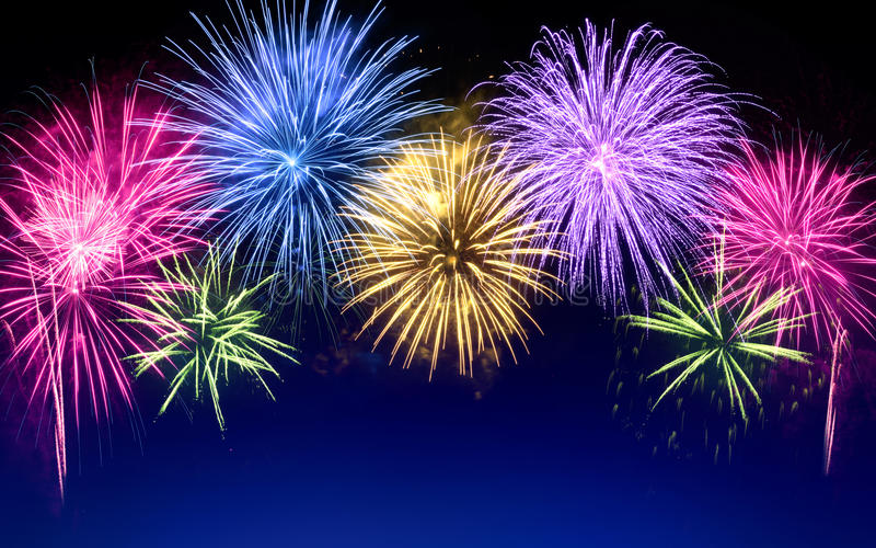 Colorful fireworks display on blue royalty free stock images