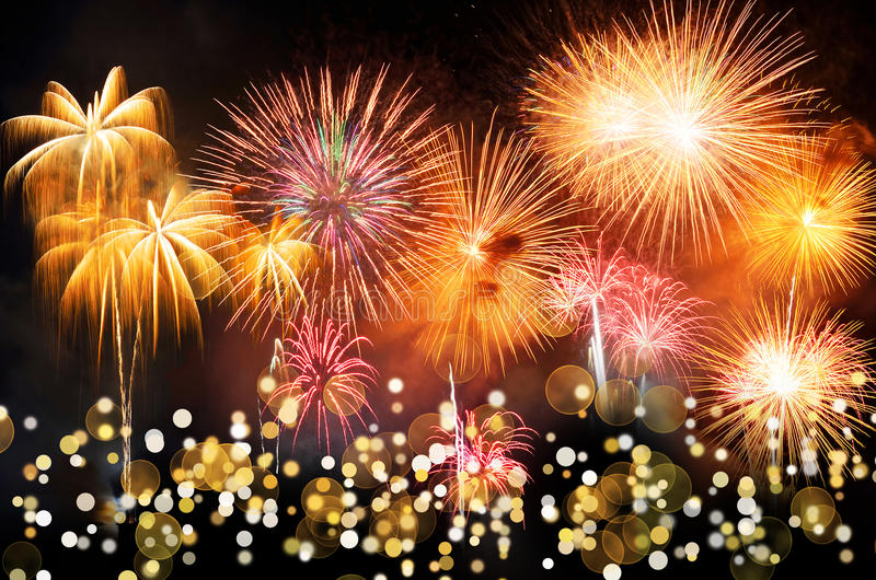 Colorful fireworks with bokeh. Fireworks are a class of explosive pyrotechnic devices used for aesthetic and entertainment. Purposes. Visible noise due to low stock photos
