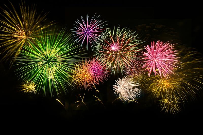 Colorful fireworks on midnight sky background stock image