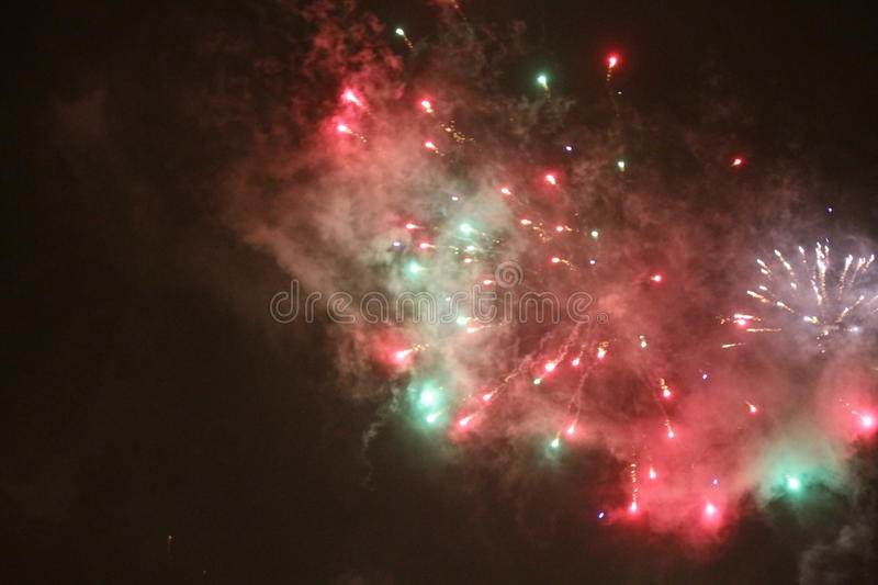 Colorful fireworks over black sky. Colorful light fireworks over black sky background stock image