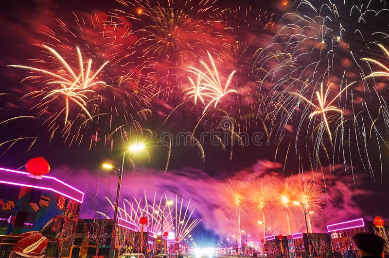 The colorful fireworks reach on the Motor city. The photo was taken in Motor City of Daqing city,Heilongjiang province, China.It was setting off fireworks to stock photo