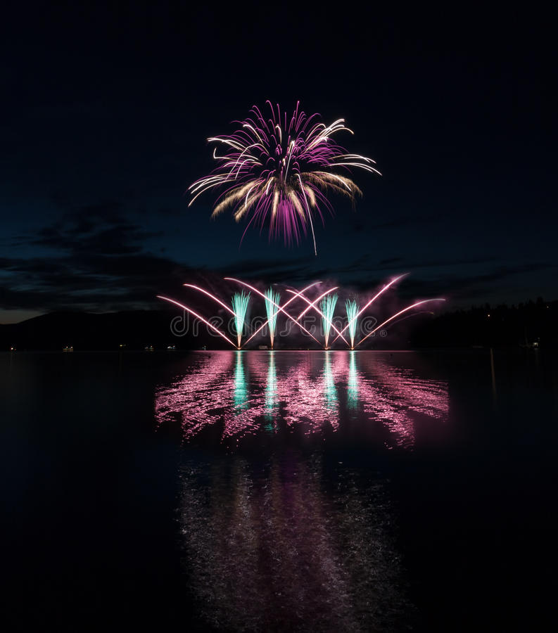 Colorful fireworks with reflection on lake. royalty free stock photography
