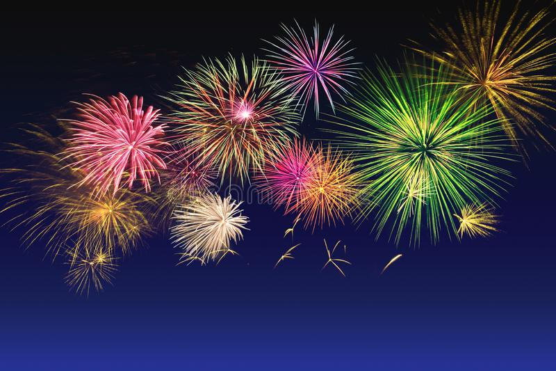 Colorful fireworks celebration on twilight sky stock images