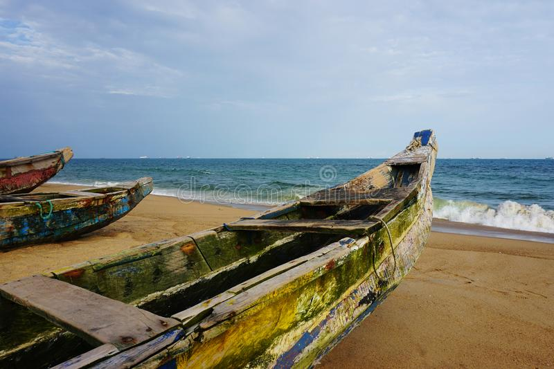 Fisher boats on the beach of lome in Togo. Colorful fisher boats lying on the sand at the beach of lome in Togo royalty free stock photography