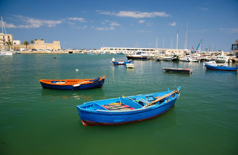 Colorful fishing boats in harbour of Bari city, Puglia, Southern royalty free stock image