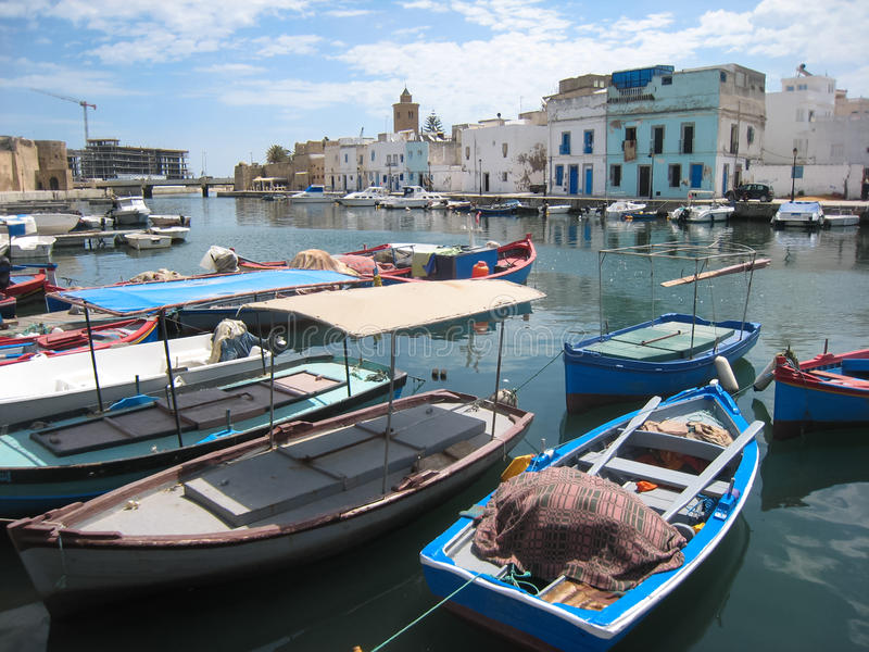 Fishing boats in the old harbour. Bizerte. Tunisia. Colorful fishing boats in the old harbour. Bizerte. Tunisia stock photo