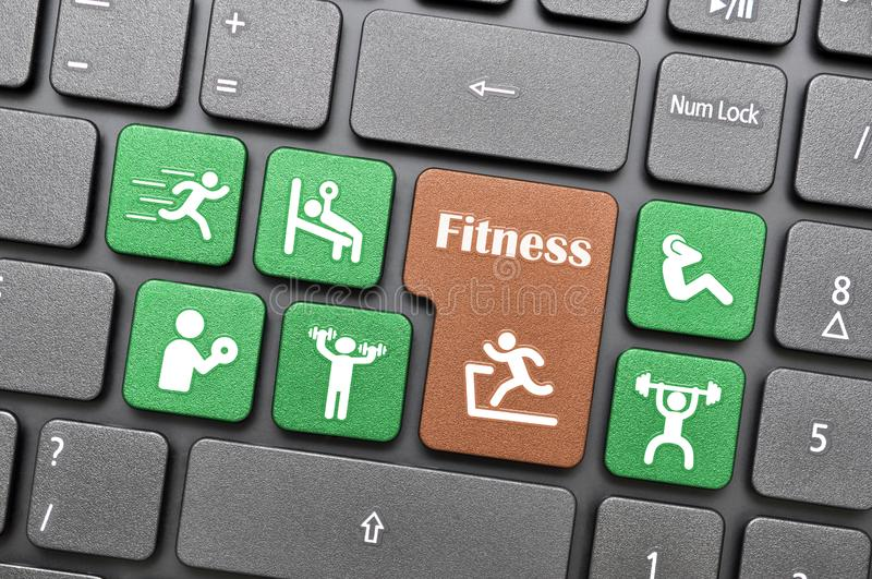 Colorful fitness symbol on keyboard royalty free stock photo