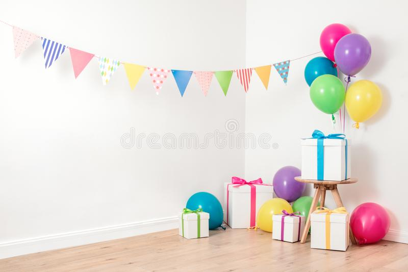 Colorful flag garland and balloons stock photography