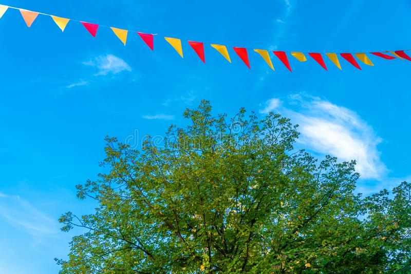 Colorful flags against the blue sky. Festival in the city. Family picnic. stock image